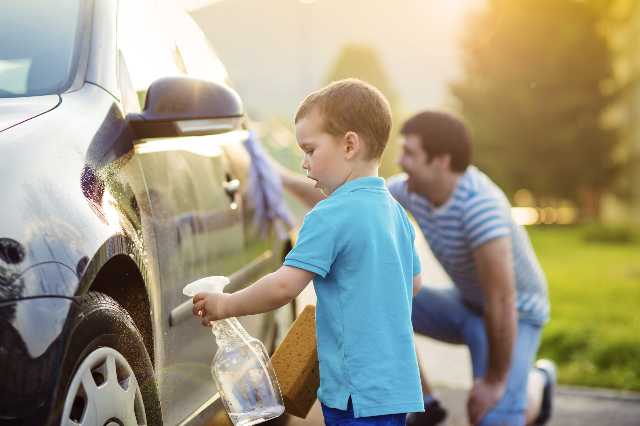 father son washing vehicle What to Expect Vehicle Shipping
