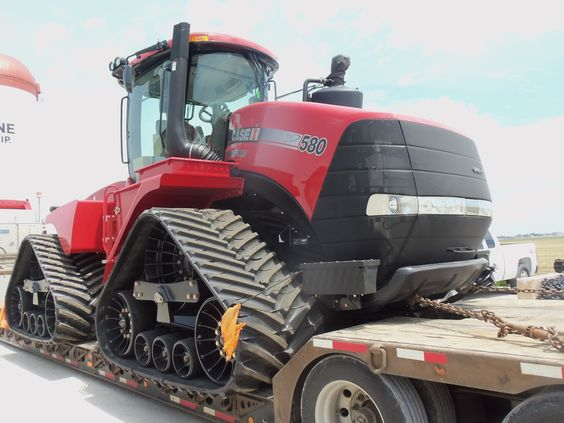 Case Tractor loaded on a low boy Heavy Equipment Shipping