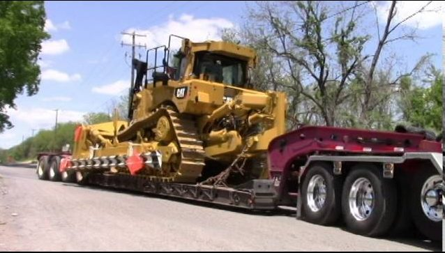 Caterpillar loaded on a low boy for transport